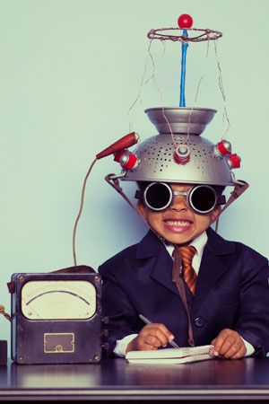 Picture of a boy with some home-made science equipment (c Getty / Andrew Rich)